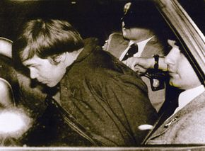 John Hinckley Jr. (L) escorted by police in Washington, D.C. on March 30, 1981, following his arrest after shooting and seriously wounding then U.S. president Ronald Reagan.
