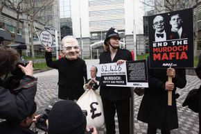A small protest against Rupert Murdoch was held outside the Thomas More Square News International offices in London after five journalists from The Sun were arrested during the Fleet Street Scandal.