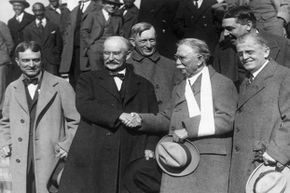 Former U.S. Secretary of the Interior Albert Fall (2nd from left) shakes hands with American oil magnate Edward Doheny, flanked by their lawyers, after their acquittal during the Teapot Dome scandal. Fall was subsequently sentenced.