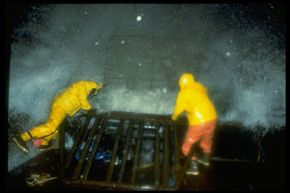 Thirty-foot (9-meter) waves, 60-knot winds and darkness make crab fishing dangerous work. See more TV show pictures.