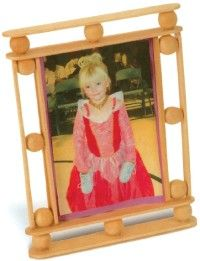 This stick-and-beads frame is ready to hold your favorite photo.