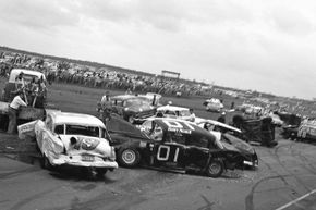 Sonny Palmer and Jimmy Mairs' cars, pictured here, were damaged after the first-lap crash at the 1960 Daytona 500. Although 37 cars were involved in the crash, the race continued.