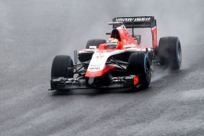 Jules Bianchi drives in the rain at the 2014 Japanese Formula One Grand Prix.