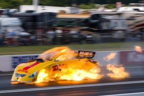 Scott Kalitta's Funny Car burst into flames when the engine exploded. Kalitta's fatal crash catalyzed the National Hot Rod Association to make major changes to the sport.