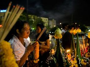A woman prays as people gather and pay homage to the late Thai Princess Galyani Vadhana during her cremation ceremony near the royal palace on Nov. 15, 2008 in Bangkok.