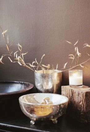Perhaps you'd like to display a Zen-like vignette. Gather up wood and metal items and pair them with a candle and flowers.