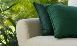 As long as the fabric is made for the outdoors, you can make the furniture as cushy as you like.