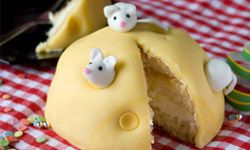 Minus the marzipan mice, this cake would be a boring, yellow dome.