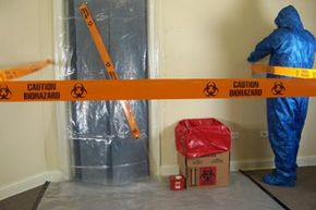 """Technicians contain an affected room by sealing with plastic sheeting, and then create an external """"buffer zone"""" outside the room to control access and restrict cross contamination from affected materials."""