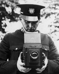 A camera always helps: A police officer trains with his new camera in 1935.