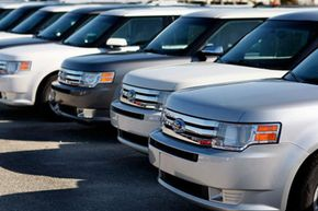 Ford Flex crossover vehicles sit on the sales lot at the Metro Ford dealership in Miami, Fla.