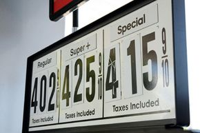 Gas pumps at a Mobil gas station in New Haven, Conn., on May 20, 2008, reflect soaring gas prices.