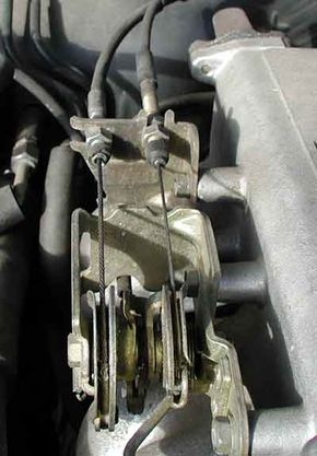 One of the cables is connected to the gas pedal, the other to the vacuum actuator.