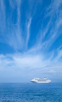 A cruise ship in the open ocean follows the laws of the flag it flies under.
