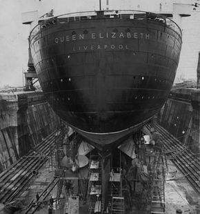 The massive U-shaped hull of the Cunard liner Queen Elizabeth as she undergoes her annual overhaul