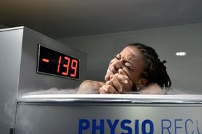 Elodie Thomis, midfielder for France's women's soccer team, reacts as she undergoes treatment in a cryotherapy chamber at the training base in Clairefontaine-en-Yvelines.