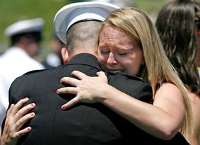 Woman cries as her brother graduates