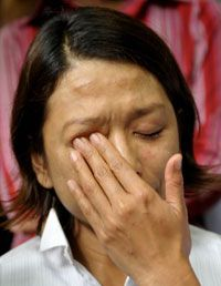 A former hostage cries after her release