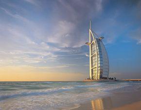 Dubai Image Gallery Dubai's Burj Al Arab towers over the Persian Gulf. See more pictures of Dubai.