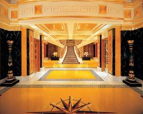 The Royal Suites at the Burj Al Arab have formal entrances and marble staircases.