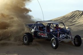 Craig Kinsman rides his dune buggy at the Imperial Sand Dunes Recreation Area near Glamis, Calif., on Nov. 22, 2002.