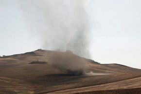 A breeze blowing at 9 miles per hour (14.5 kilometers per hour) can stir up dust on the ground. If the particles are small enough, they may become airborne.