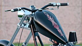 Red-and-white pinstriping on Daddy Long Legs' gas tank stands out against an unusual satin-black background.