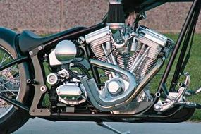 Specially bent pipes add another distinctive touch; the chopper's foot controls are set far forward to accommodate the tall rider.