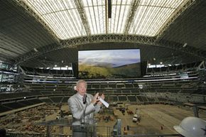 Dallas Cowboys owner and general manager Jerry Jones addresses the press in front of the world's largest HDTV.