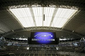 The scoreboard is secured to the two steel arches that support the stadium's roof.