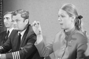 """Flight attendant Tina Mucklow (right) described the hijacker as """"not nervous."""" Captain Bill Scott (center) said, """"We first knew he was not aboard when we arrived in Reno."""" First officer Bill Rataczak is at left."""