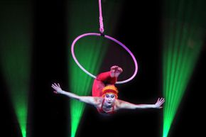 Acrobats like this aerial hoop artist perform daring stunts that require strength, skill and a lot of bravery.