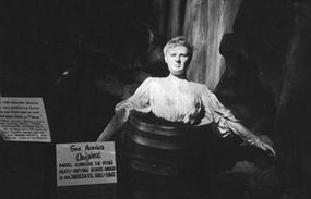 Wax figure of Mrs. Annie Edson Taylor, sitting in a barrel, in the Niagara Falls Museum.