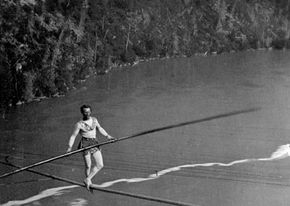 "French acrobat and tightrope-walker ""The Great Blondin"" crossing Niagara on a tightrope."