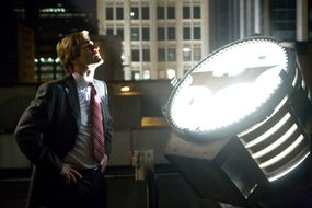 "Aaron Eckhart stars as District Attorney ""Harvey Dent."""