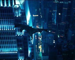 """""""Batman"""" flies through the air in the fictional Gotham City."""