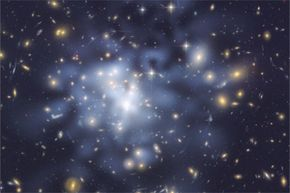 You're looking at arguably one of the best maps of dark matter that we have. Astronomers tinted the dark matter concentrations in the giant galaxy cluster Abell 1689 blue. They figured out the location of those concentrations by using gravitational lensing.