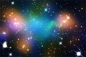 """This composite image of the merging galaxy cluster Abell 520 has superimposed, """"false-colored"""" maps that show the cluster's concentration of starlight (orange), hot gas (green) and dark matter (much of the blue)."""