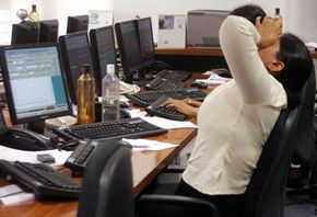 In May 2006, an Indian stock dealer copes with news that Indian share prices fell 6 percent in early trading in Mumbai.