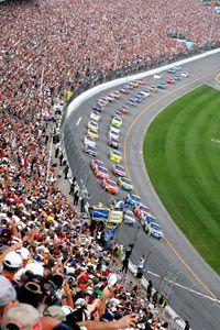 Fans watch cars race through the trioval at the Daytona International Speedway in Daytona Beach, Fla., Sunday, Feb. 17, 2008.