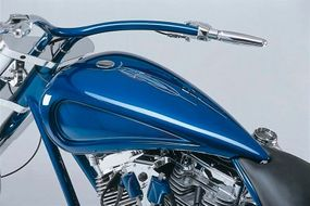 DD Custom Cycles Pro Street fuel tank features inset side panels and is accented with contrasting pinstripes.