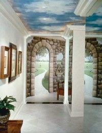The monochromatic floor and walls are a fine segue for the natural tones of the mural.