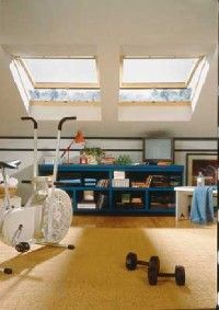 Skylights welcome light and air into this workout space.