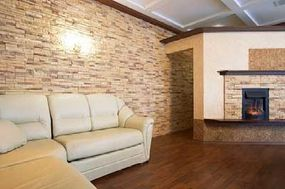 The stone in the walls carries into the fireplace and unites the room.