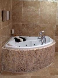 Although the tiles of the walls, tub,                              and floor are different, their similar                                            colors create harmony.