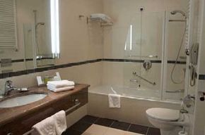 The grab bar in the shower helps prevents falls, and the telephone near the toilet ensure that -- should an accident occur -- help is close at hand.