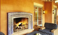 This fireplace perfectly complements the outdoor patio.