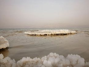 Salt crystals on the banks of the Dead Sea show evidence of the receding water level.