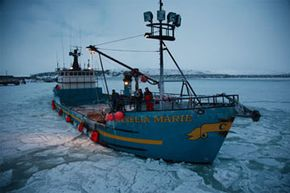 F/V Cornelia Marie navigates slowly through icy waters.