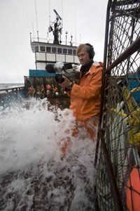 Cameraman Marc Carter braves the conditions for the right shot.